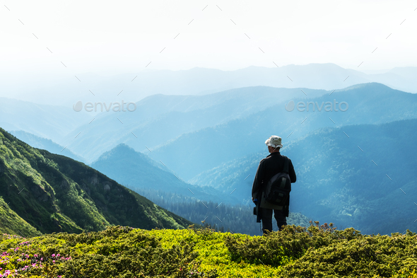 Man silhouette on foggy mountains - Stock Photo - Images
