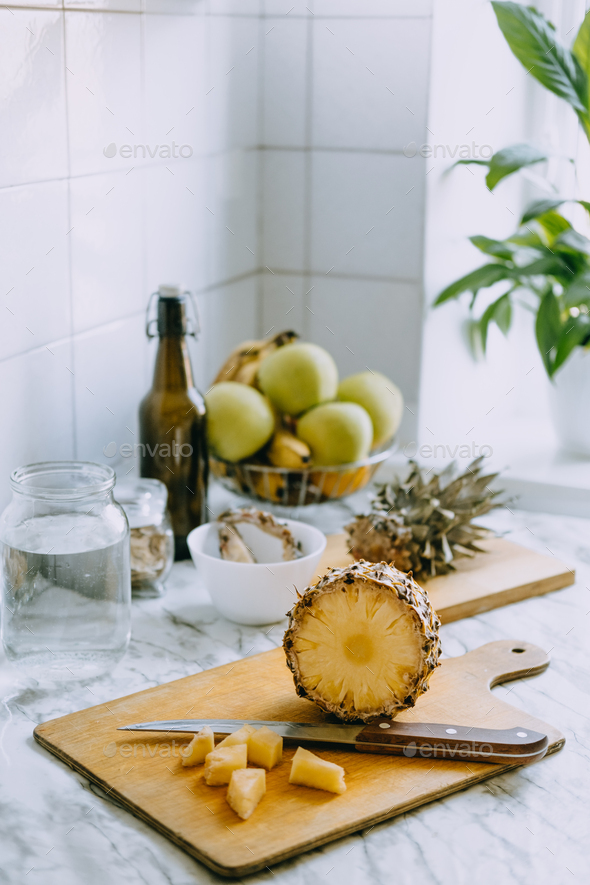 Fermented pineapple kombucha drink tepache. Cooking process of homemade probiotic superfood - Stock Photo - Images