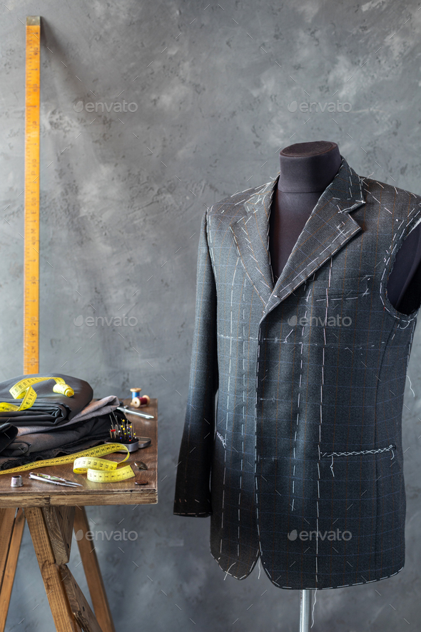 suit jacket on male tailor mannequin and sewing tools, - Stock Photo - Images