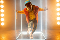 Stylish rapper on the stage with illuminated cube - PhotoDune Item for Sale
