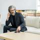 Elegant mature businessman using mobile gadgets in modern luxurious restaurant - PhotoDune Item for Sale