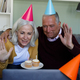 Senior caucasian couple celebrating birthday while having a video chat on laptop at home - PhotoDune Item for Sale