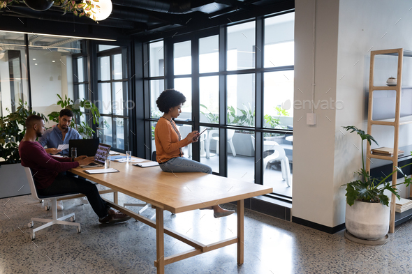 Diverse group of business people working in creative office - Stock Photo - Images