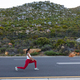 Fit african american woman in sportswear stretching on a coastal road - PhotoDune Item for Sale