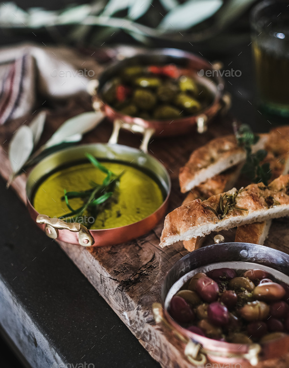 Traditional Mediterranean meze appetizers platter on wooden board - Stock Photo - Images