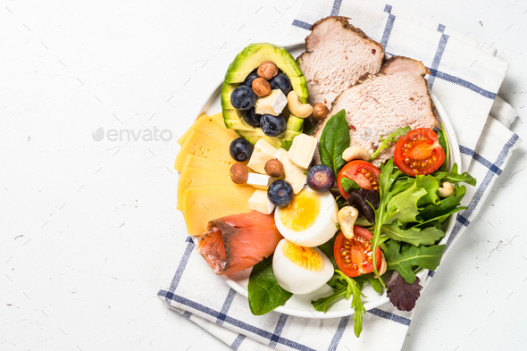 Keto diet plate on white table. - Stock Photo - Images