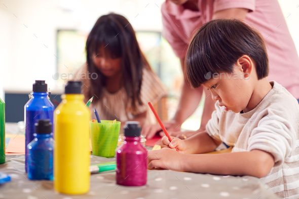 Asian Father With Children Having Fun With Children Doing Craft On Table At Home - Stock Photo - Images