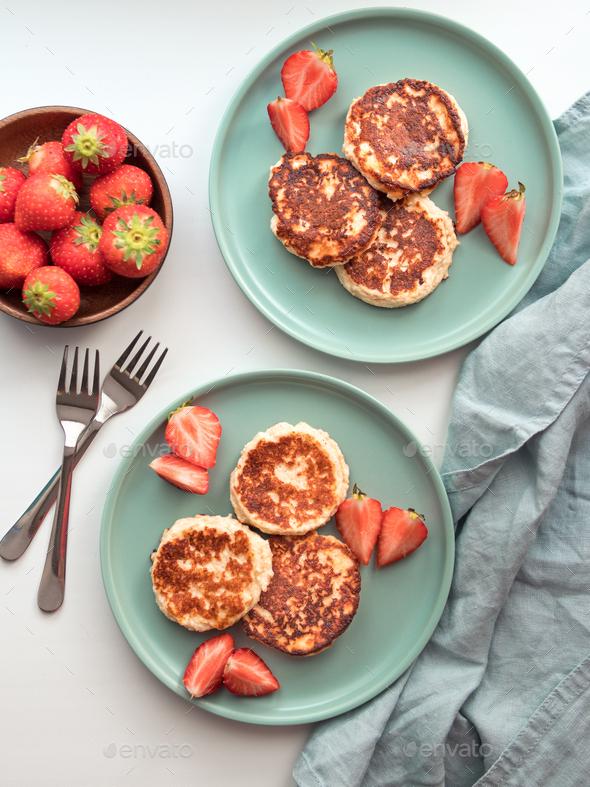 Cottage cheese pancakes, syrniki, ricotta fritters - Stock Photo - Images