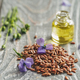 Flax seeds and flaxseed oil with copy space - PhotoDune Item for Sale