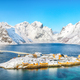 Breathtaking winter view of Sakrisoy village and snowy mountaines on background. - PhotoDune Item for Sale