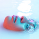 Beautiful female face in the milk bath with soft glowing in blue-pink neon light - PhotoDune Item for Sale