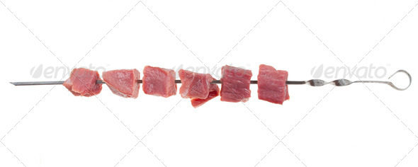 Pieces of raw meat on a skewer - Stock Photo - Images
