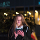 Beautiful woman using tablet in the city at night - PhotoDune Item for Sale