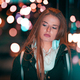 Beautiful woman at night in the city among colorful lights - PhotoDune Item for Sale