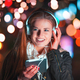 Woman with headphones using tablet and listening music in city at night - PhotoDune Item for Sale