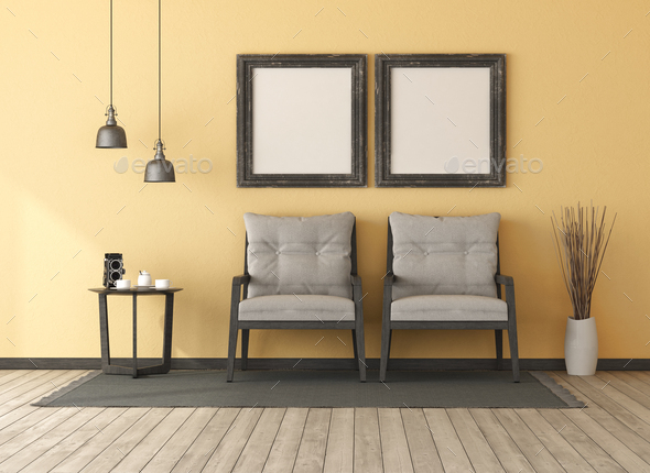 Two wooden armchairs in a yellow room - Stock Photo - Images