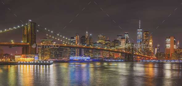 Panorama scene of New york Cityscape with Brooklyn Bridge over the east river - Stock Photo - Images