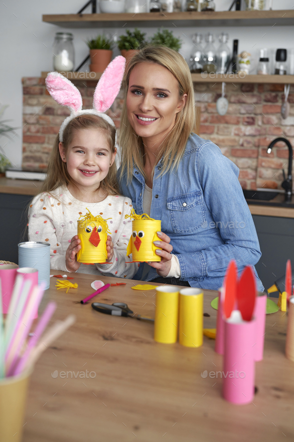 Portrait of mother and daughter with handmade Easter chickens - Stock Photo - Images