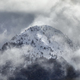 beautiful snowy mountain top in clouds - PhotoDune Item for Sale