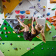 Young woman bouldering in indoor climbing gym - PhotoDune Item for Sale