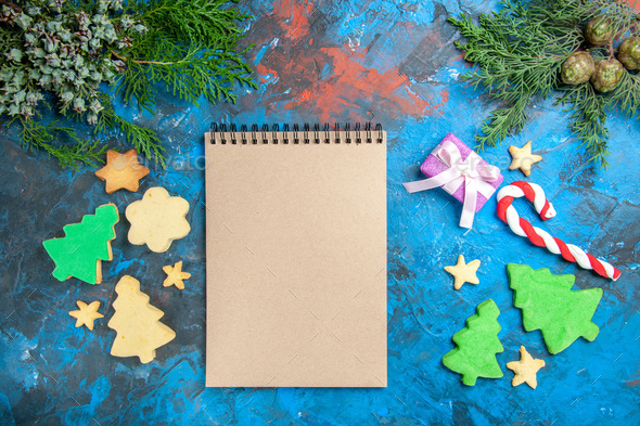 Open Christmas Presents 2021 Top View Open Notepad With Presents On Blue Background Photo Xmas Holiday Color Stock Photo By Kamranaydinovstudio
