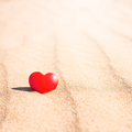 Romantic symbol of red heart on the sand beach - PhotoDune Item for Sale