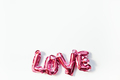 Love concept. Inflatable pink balloon with letters - PhotoDune Item for Sale