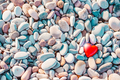 Romantic symbol of red heart on the pebble beach - PhotoDune Item for Sale