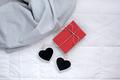 Romantic present in bed. Valentine concept - PhotoDune Item for Sale