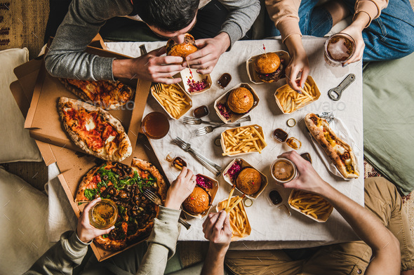 Quarantine home beer party with fast food delivered foods Stock Photo by  sonyakamoz