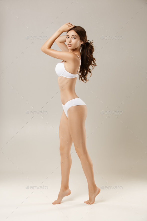Woman with natural slim tanned body in underwear - Stock Photo - Images