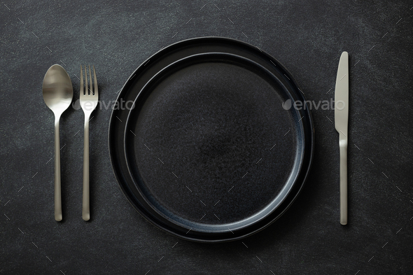 Empty Black Plates with Silver Cutlery. - Stock Photo - Images