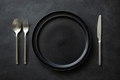 Empty Black Plates with Silver Cutlery. - PhotoDune Item for Sale