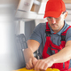 RV Industry Technician Inside Modern Travel Trailer - PhotoDune Item for Sale