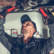 Caucasian Professional Car Mechanic Undercarriage Check - PhotoDune Item for Sale