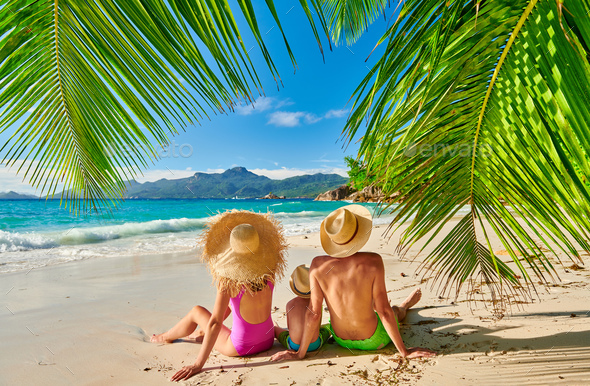 Family with three year old boy on beach. Seychelles, Mahe. - Stock Photo - Images
