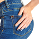 Young girl in jeans with blue manicure. Focus on the hand. - PhotoDune Item for Sale