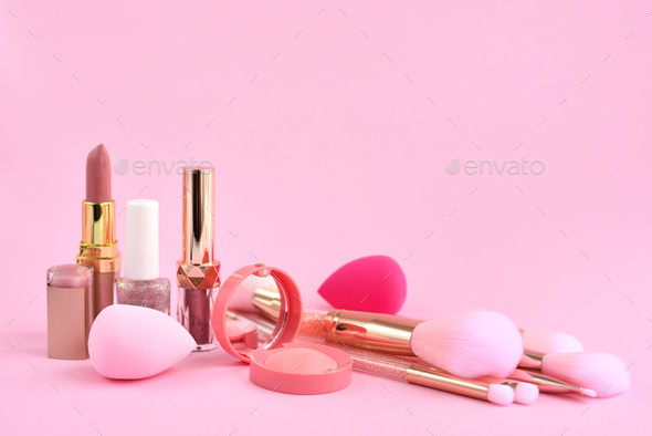 Decorative cosmetics, sponges  and make-up brushes on a pink background - Stock Photo - Images