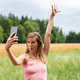 Young woman making selfies in nature - PhotoDune Item for Sale