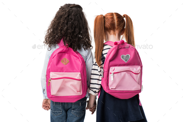 back view of cute multiethnic schoolgirls with backpacks standing together isolated on white - Stock Photo - Images