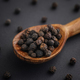 Organic whole black peppercorns in a wooden spoon - PhotoDune Item for Sale