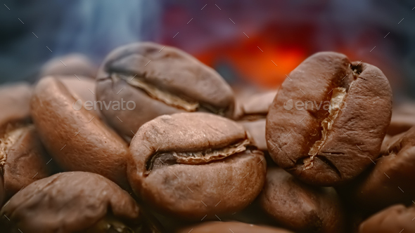 Close up of seeds of coffee. Fragrant coffee beans are roasted smoke comes from coffee beans. - Stock Photo - Images
