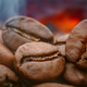 Close up of seeds of coffee. Fragrant coffee beans are roasted smoke comes from coffee beans. - PhotoDune Item for Sale