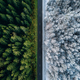 Aerial view of a highway road through the forest in summer and winter. - PhotoDune Item for Sale