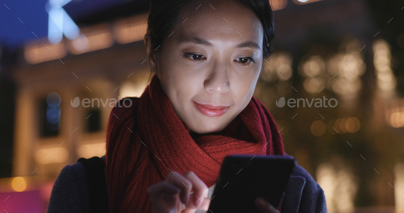 Young Woman use of cellphone in city at night - Stock Photo - Images