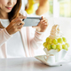 Young woman taking photo of bingsu with smart phone in restaurant - PhotoDune Item for Sale