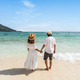 Young couple traveler relaxing and enjoying at beautiful tropical white sand beach - PhotoDune Item for Sale
