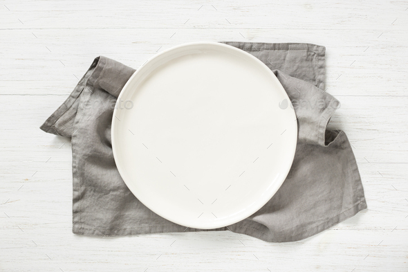 Empty Plate on Gray Napkin on Wooden Table. - Stock Photo - Images