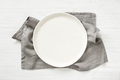 Empty Plate on Gray Napkin on Wooden Table. - PhotoDune Item for Sale