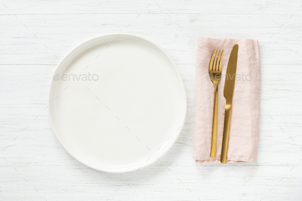 Empty Plate ang Golden Cutlery on Table. - Stock Photo - Images